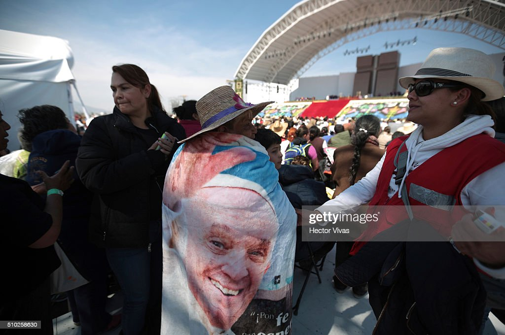 A woman with a flag of Pope Francis is seen during a mass for the people at Ecatepec on February 14, 2016 in Ecatepec, Mexico. Pope Francis is on a five days visit in Mexico from February 12 to 17 where he is expected to visit five states.