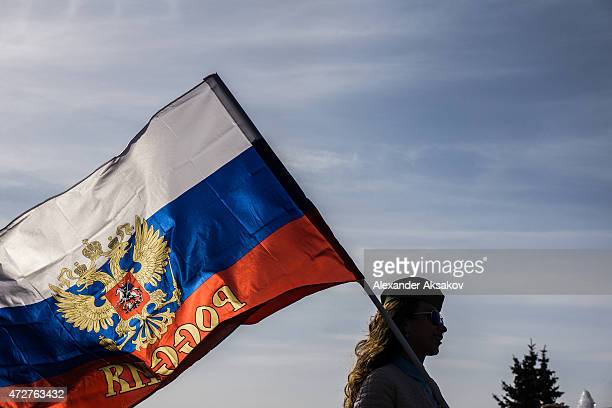 A woman with a flag of Russia in the Victory Park during celebrations marking the 70th anniversary of the victory over Nazi Germany and the end of...