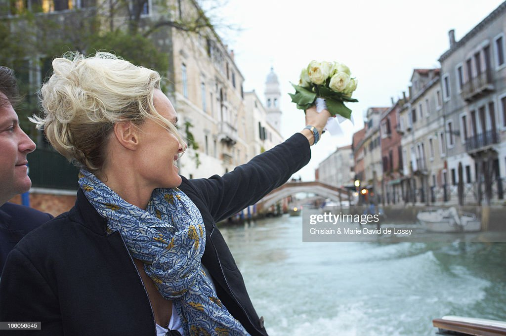 Woman with a flower bouquet : Stock Photo