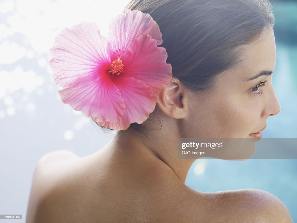 Woman with a flower in her hair : Stock Photo