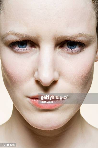 A woman with a furrowed brow, extreme close up