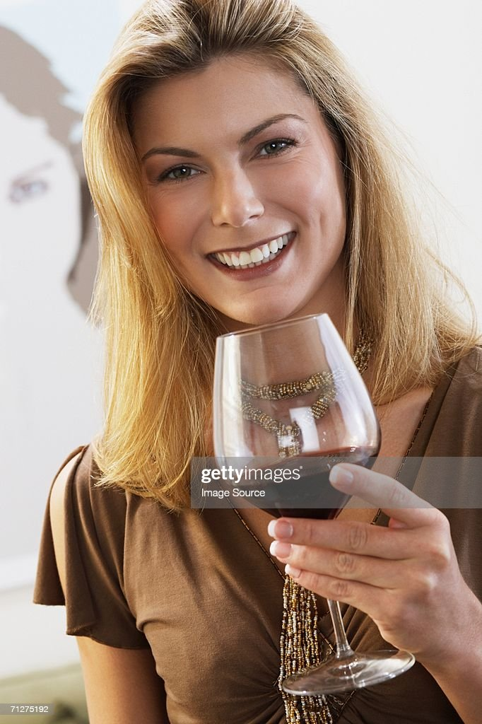 Woman with a glass of wine : Stock Photo