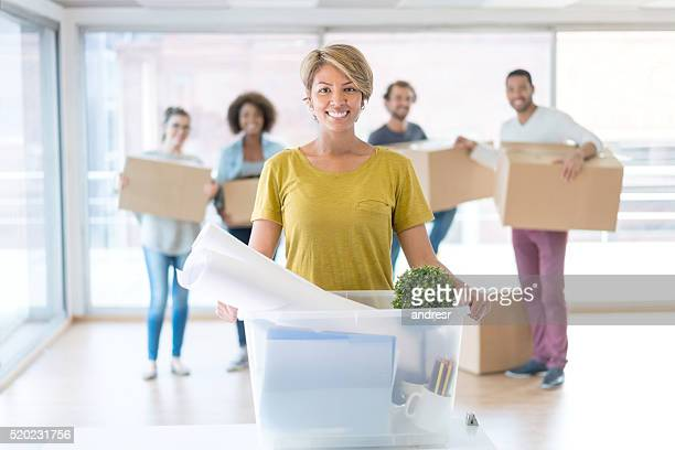 Woman with a group of coworkers moving office