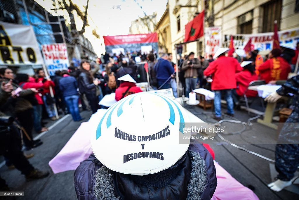 A woman with a hat that says 'Workers trained and unemployed' in the march against the economic policies in Montevideo on June 29, 2016.The PIT-CNT (the only organization of unionized workers of Uruguay) today made a partial strike and marched to front the Ministry of Economy of Uruguay.