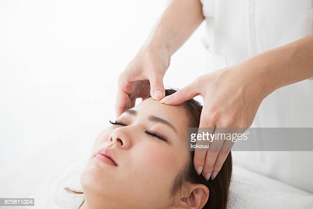 Woman with a head massage