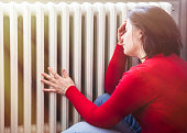 woman with a headache worried about the quality of the heating