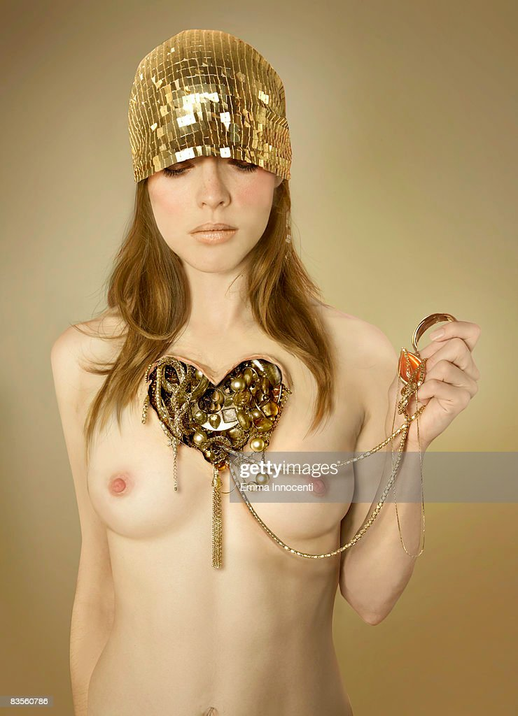 Woman with a heart of gold : Stock Photo