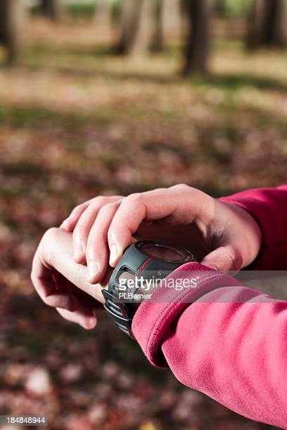 Woman with a heart rate monitor watch.