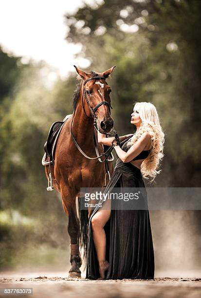 Woman with a horse.