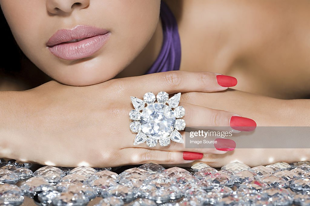 Woman with a large diamond ring : Stock Photo
