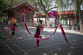 A woman with a long ribbon taking part in morning exercises in Beihai Park an imperial garden to the northwest of the Forbidden City in Beijing China...