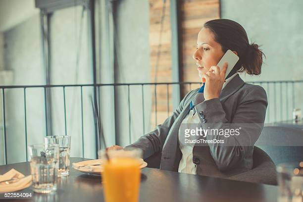 Woman with a mobile phone in restaurant