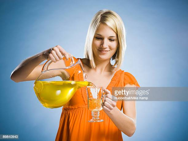 woman with a pitcher of lemonade