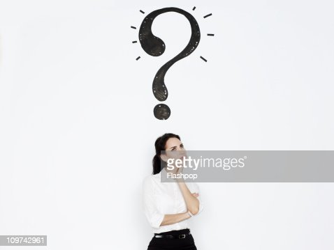 Woman with a question mark above her head : Stock Photo