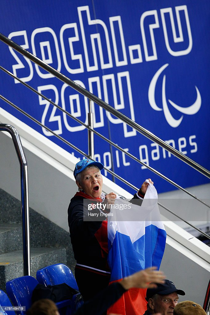 A woman with a Russian flag shows her support during the Ice Sledge Hockey Classification match between the Czech Republic and Korea at the Shayba Arena during day five of the 2014 Paralympic Winter Games on March 12, 2014 in Sochi, Russia.