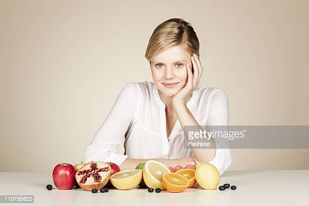 Woman with a selection of fresh fruit