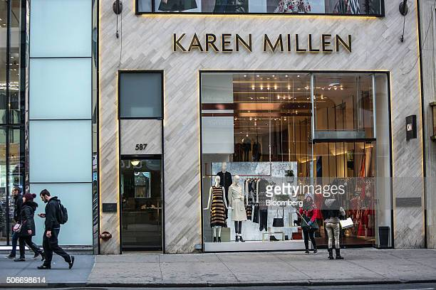 A woman with a selfie stick stands outside a Karen Millen Group Ltd store in New York US on Friday Jan 15 2016 The New Yorkbased private research...