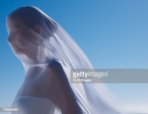 Woman with a sheer sheet
