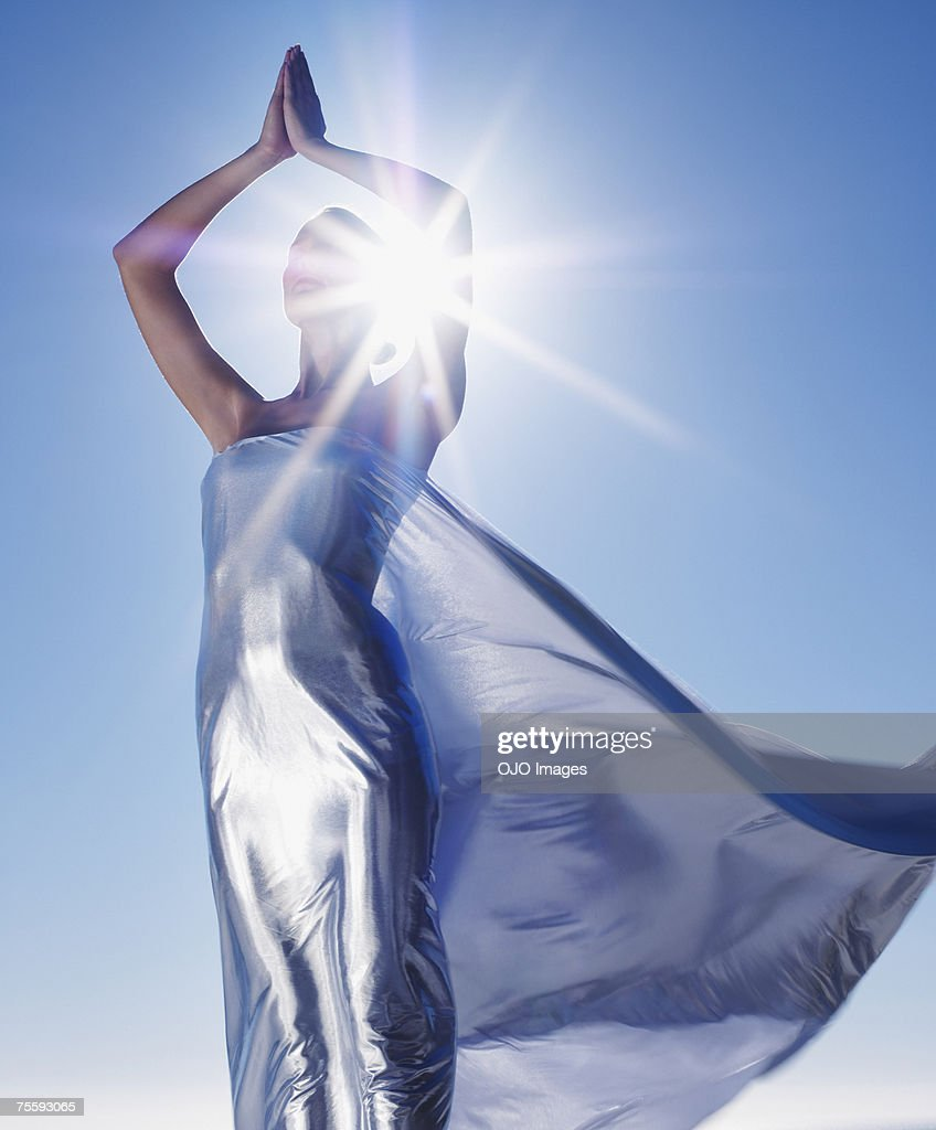 Woman with a sheer sheet : Stock Photo
