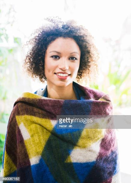 Woman with a smile and wool garment on.