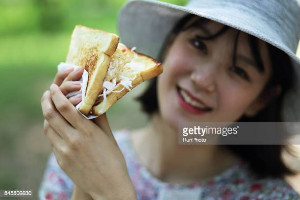 woman with a smiling face with bread