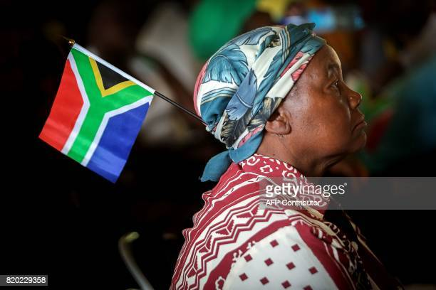 A woman with a South African flag pinned to her headscarf attends a commemoration under theme of unity in action marking the 50th anniversary of the...
