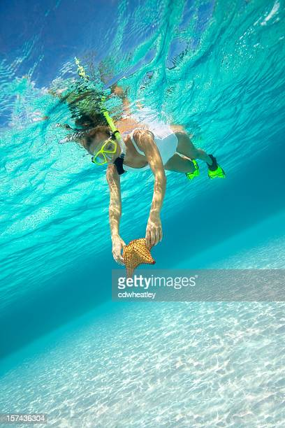 woman with a starfish underwater