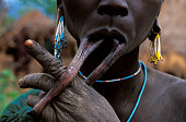 A woman with a stetch out lip from having worn a lip plate Lip plates are the most famous feature of the Surma women who live in the Omo Valley in...