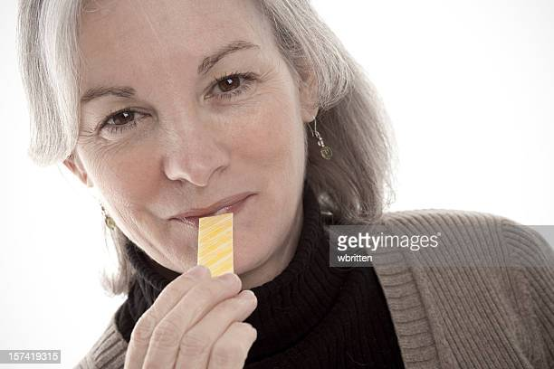 Woman with a stick of gum