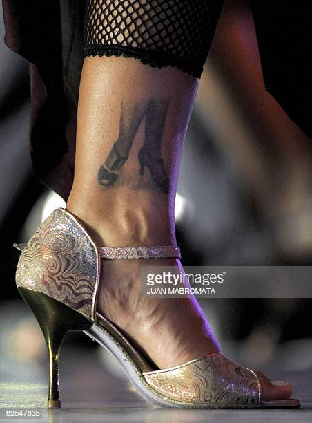 A woman with a tatoo depicting female tango feet participates of the qualifying round of the Tango Salon competition during the 6th edition of the...