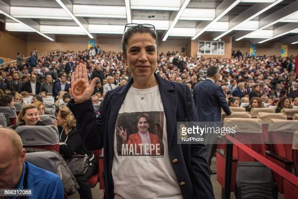 A woman with a Turkish flag drawn on her hand in henna wears a Tshirt bearing Meral Akener a former MHP deputy who on 25 October 2017 launched the...