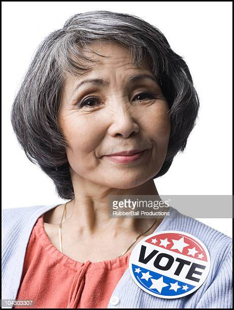 woman with a 'vote' button