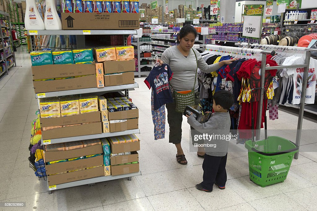 A woman with a young boy shops for clothes at a Bodega Aurrera store, the discount chain owned by Wal-Mart Stores Inc., in Naucalpan de Juarez, Mexico, on Wednesday, May 4, 2016. Wal-Mart de Mexico SAB reported first-quarter results last week that beat analysts estimates, the most recent sign of growth for Mexican companies this earnings season. Photographer: Susana Gonzalez/Bloomberg via Getty Images