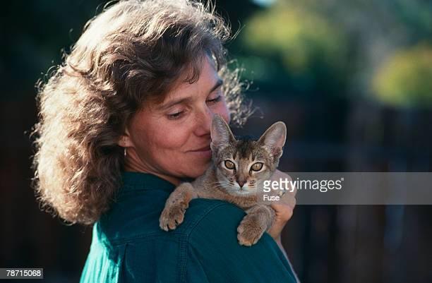 Woman with Abyssinian Ruddy Kitten