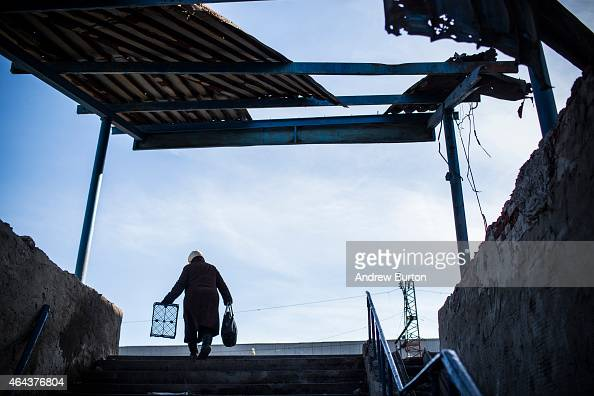 A woman with an empty basket walks through town as Russian backed rebels donate food medicine and money to people on February 25 2015 in Debaltseve...
