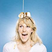 woman with an ice cream sundae on her head