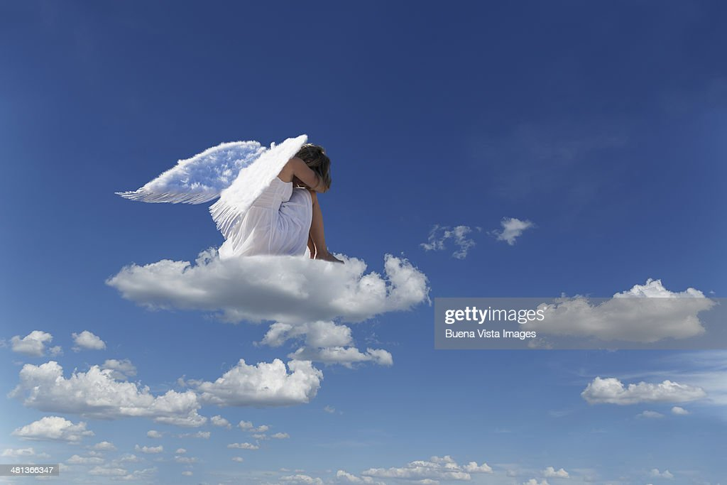 Woman with angel's wings on a cloud : Stock Photo