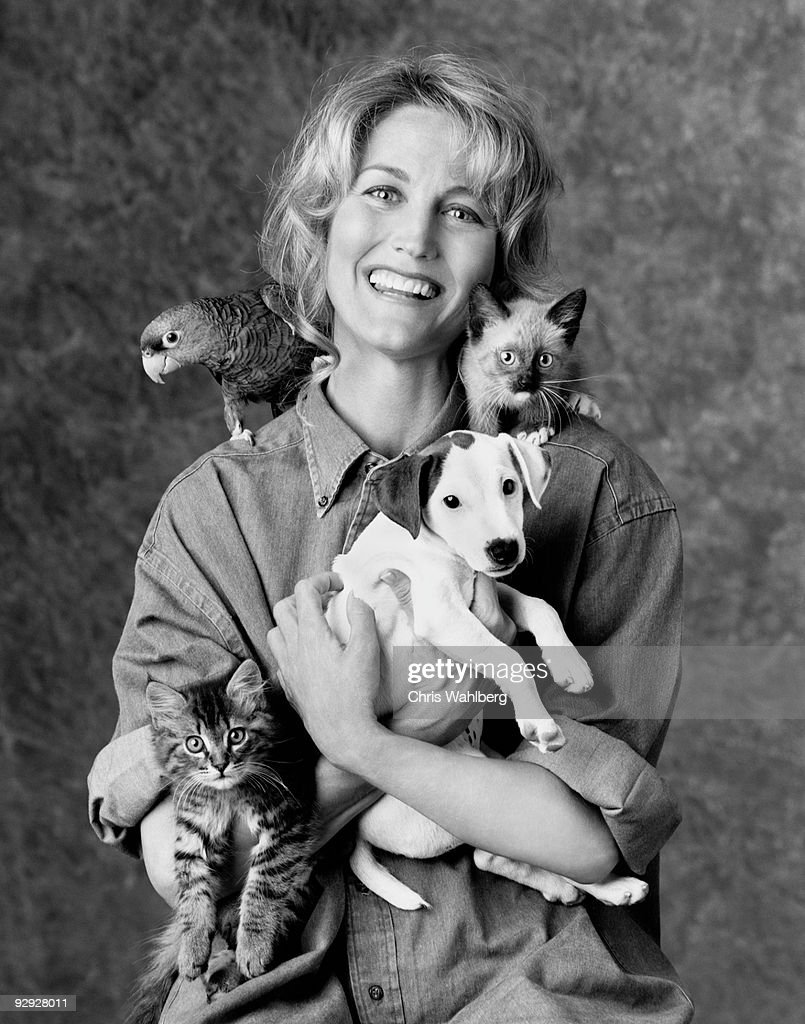 Woman with animals : Stock Photo