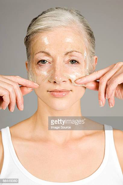Woman with anti-aging face mask