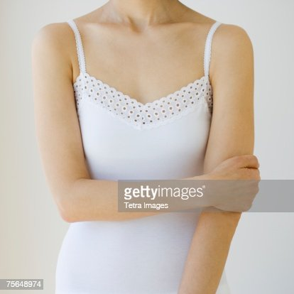 Woman with arm crossed over torso