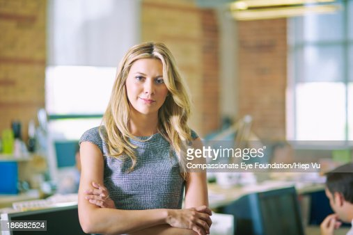 Woman with arms crossed in office