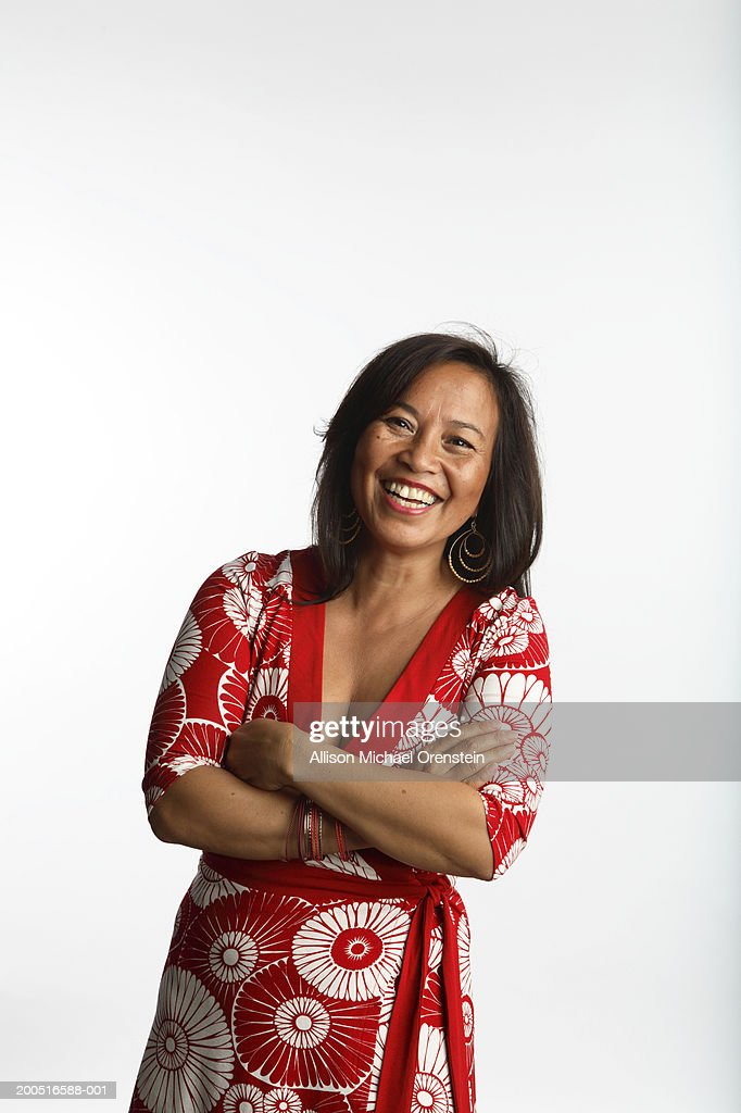 Woman with arms crossed, smiling, portrait : Stock Photo