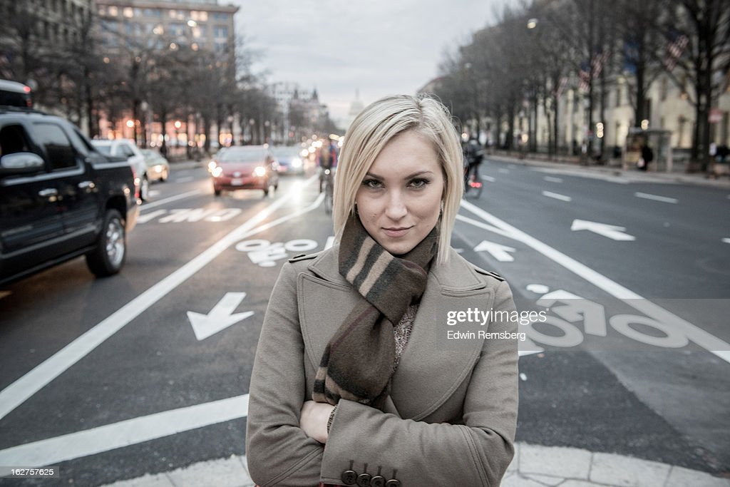 Woman with arms folded standing in bike lanes. : Stock Photo