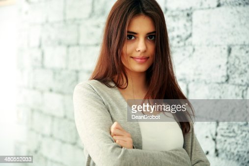woman with arms folded standing : Stock Photo