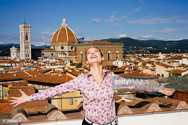 Woman with arms outstretched, Florence, Italy