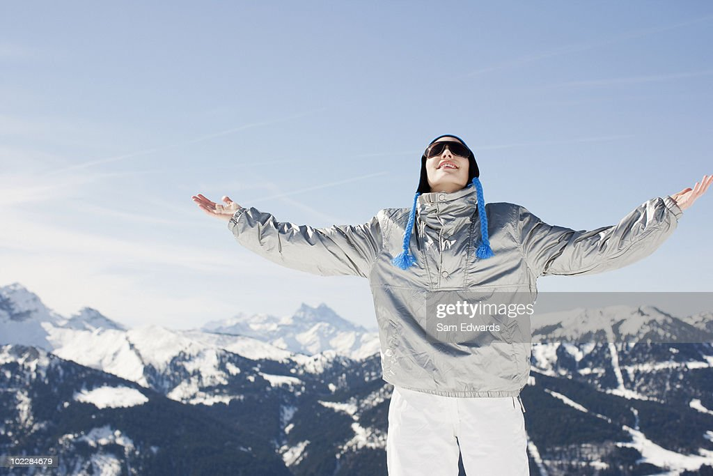 Woman with arms outstretched on mountain top : Stock Photo