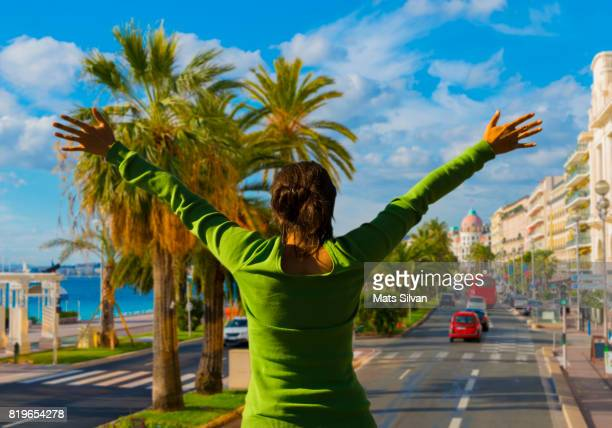 Woman with Arms Outstretched Over Nice City