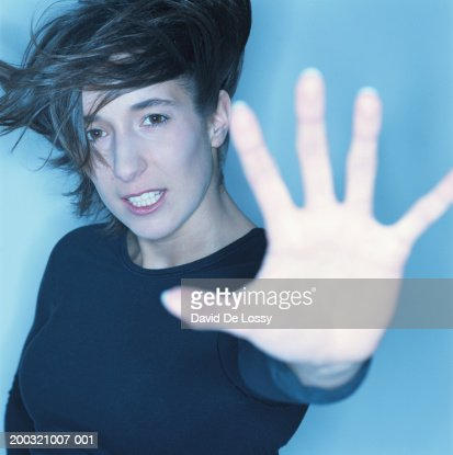 Woman with arms outstretched, portrait : Stock Photo
