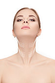 woman with arrows on her face over white background. neck lifting concept. correction of double chin
