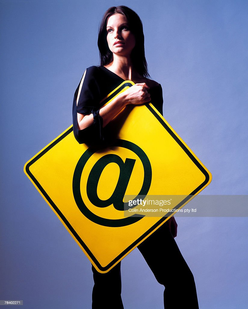 Woman with at symbol : Stock Photo
